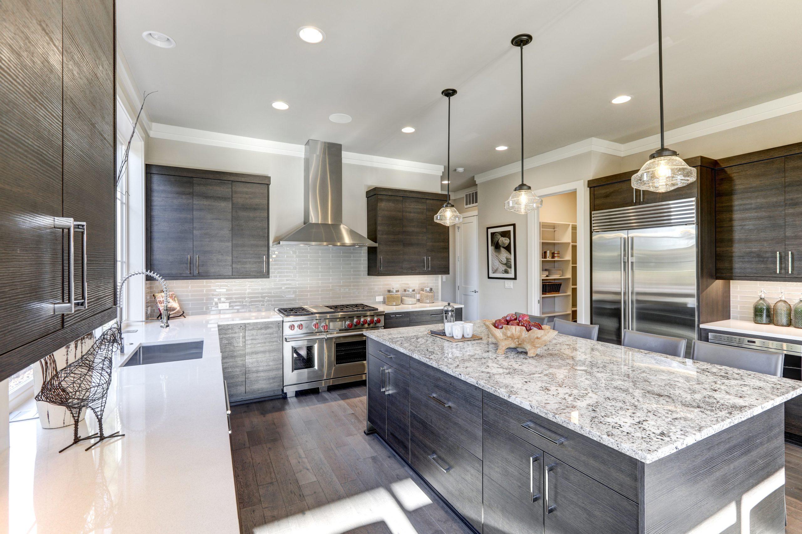 Modern-gray-kitchen-features-dark-gray-flat-front-cabinets