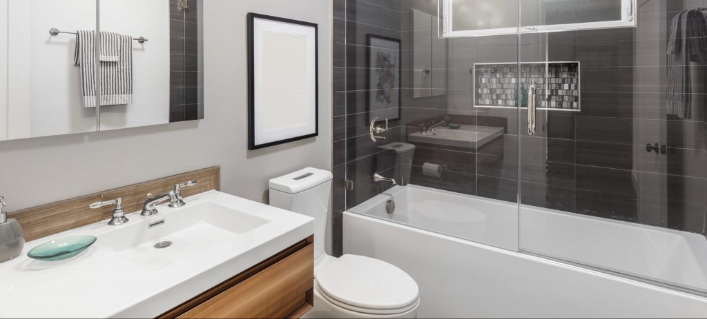 Designer-Bathroom-with-Glass-Shower-and-wooden-cabinet